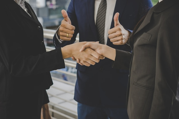 Business people shaking hands, finishing up meeting deals. business concept. Free Photo