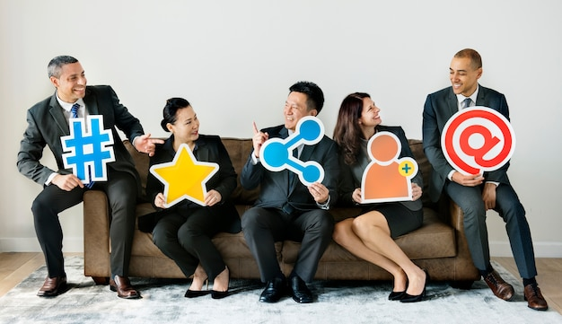 Business people sitting together with icons Premium Photo