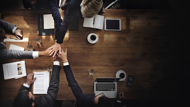 Business people stacking their hands Premium Photo