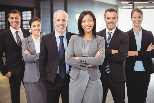Business people standing with arms crossed Premium Photo