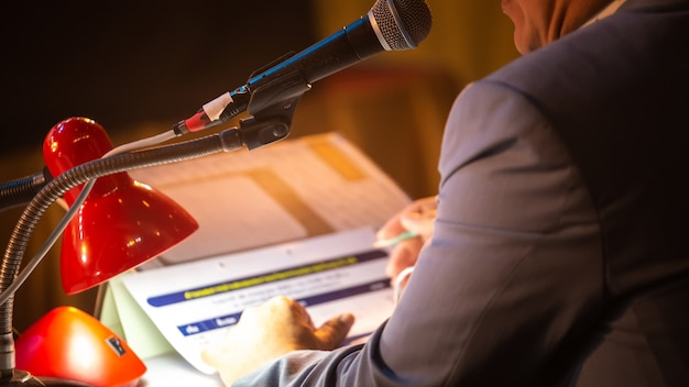 Business people talking on seminar panel with microphone Premium Photo