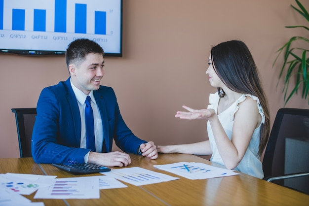 Business people talking at a table Free Photo