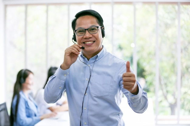Business people talking on telephone with headset at office for customer help service concept Premium Photo