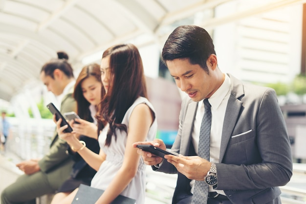 Business people using smartphone while together Free Photo