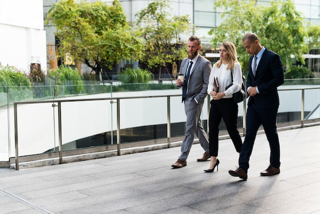 Business people walking together outside the office Free Photo