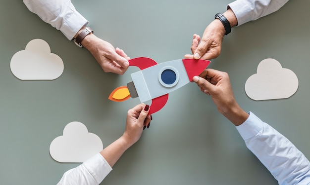 Business people with startup rocket Premium Photo