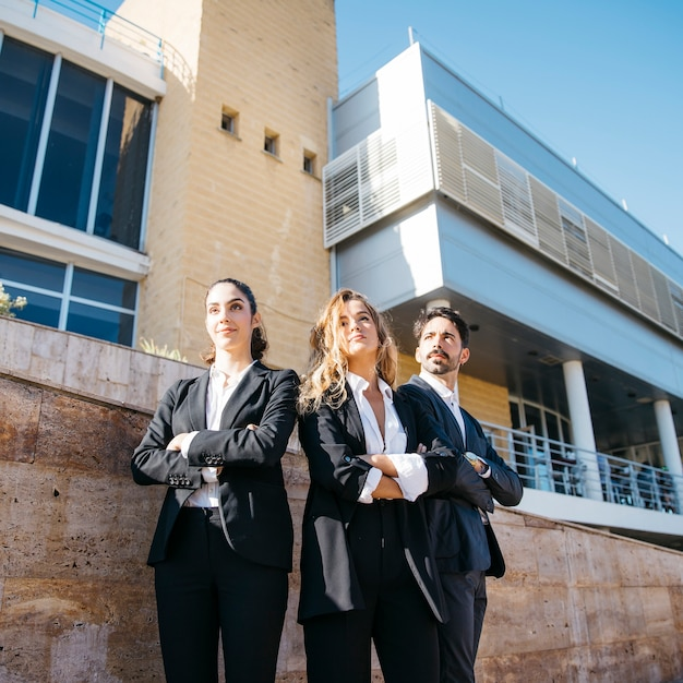 Business persons in front of building Free Photo