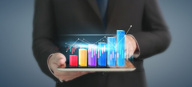 Business plan graph growth and increase of chart positive indicators in his business, tablet in han