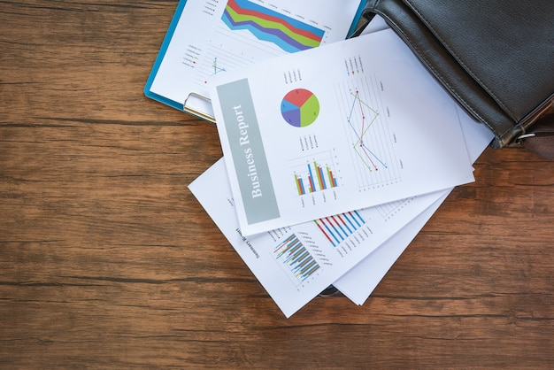 Business report chart preparing graphs on briefcase bag / summary report in statistics circle pie chart on paper business document Premium Photo