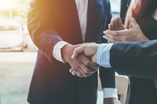 Business shaking hands. business executives to congratulate the joint. Premium Photo