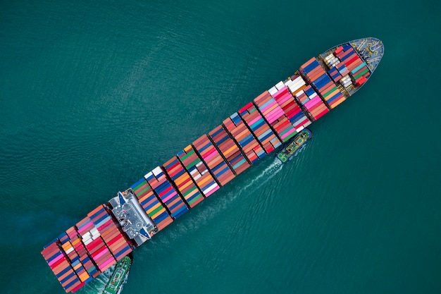 Business and shipping cargo containers by special large shipping vessels service industry transportation import and export international products open sea aerial view Premium Photo