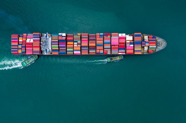 Business and shipping cargo containers by special large shipping vessels Premium Photo