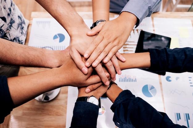 Premium Photo | Business startup teamwork joining hands ...