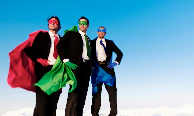 Business superhero posing unanimaously and looking away from the camera. Premium Photo