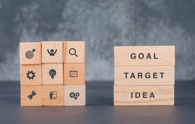 Business target concept with wooden blocks with icons on it side view. Free Photo