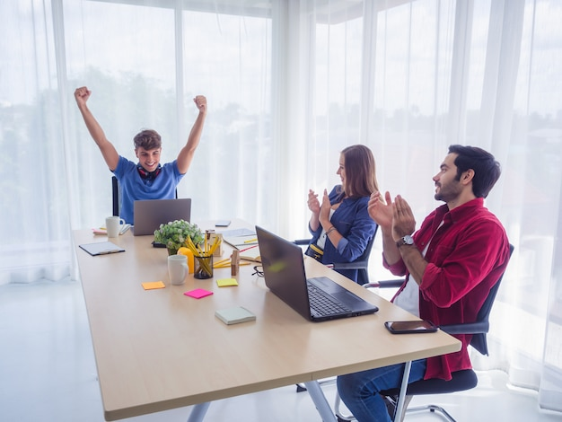 Business team celebrating victory in office, business success Premium Photo