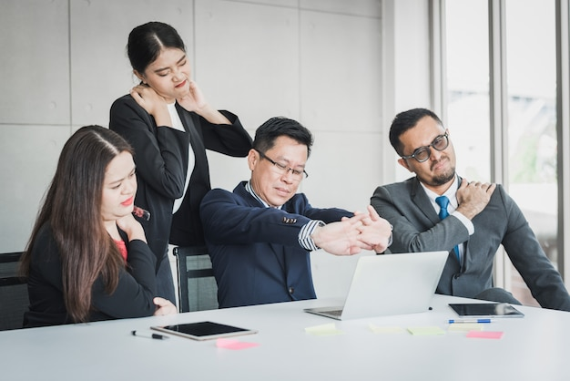 Business team feeling pain in neck and shoulder Premium Photo