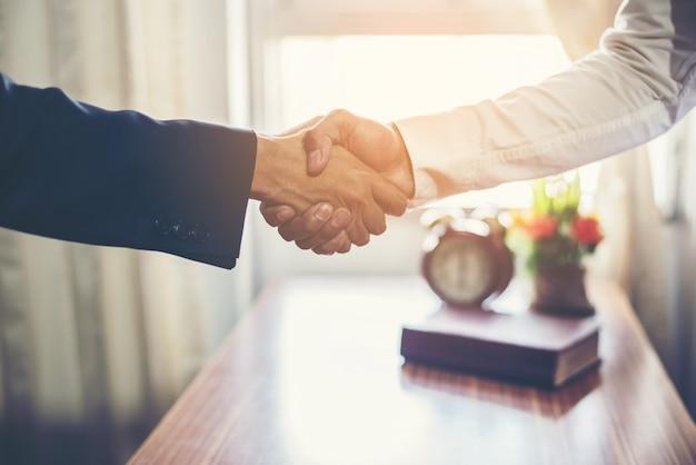 Business team handshake success. Free Photo