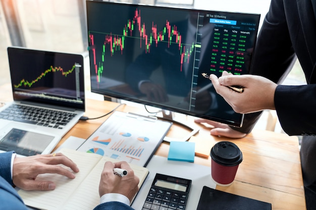 Business team investment entrepreneur trading discussing and analysis data the stock market charts and graphs negotiation and research budget Premium Photo