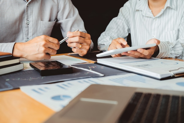 Business team investment entrepreneur trading discussing and analysis graph stock market trading,stock chart concept Premium Photo