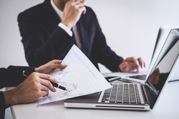 Business team investment working with computer and analysis graph stock market trading Premium Photo