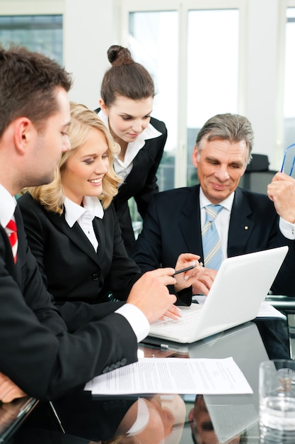 Business - team meeting in an office Premium Photo