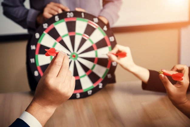 Business team pointing to a darts aiming at the target center business,targeting the business concept Premium Photo