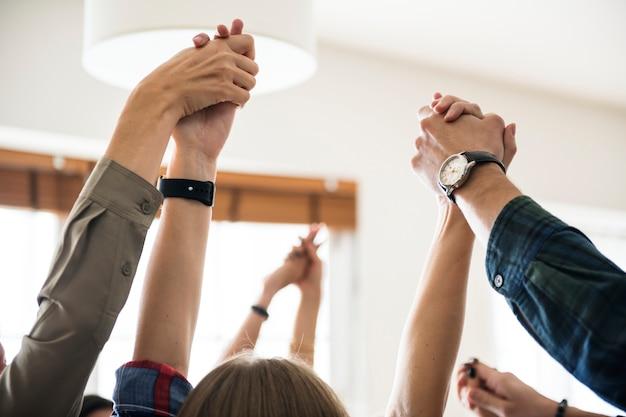 Business team raising their hands up to celebrate Premium Photo