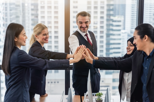 Business team showing unity with their hands together. unity and teamwork concept Premium Photo