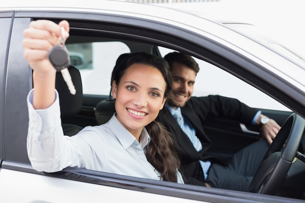 Business team smiling and driving Premium Photo