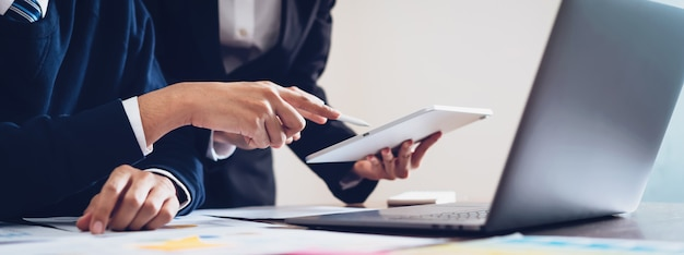 Business team using tablet and laptop computer to work in the office. Premium Photo