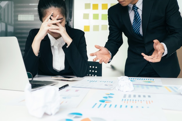 Business teamwork blaming partner and serious discussion. Premium Photo