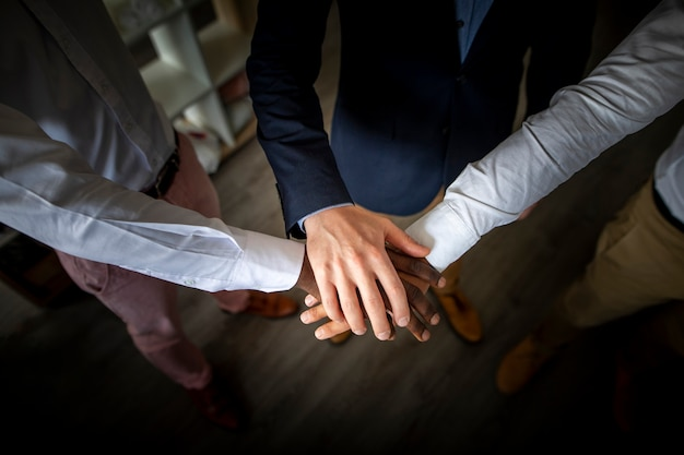 Business teamwork joining hands together Free Photo