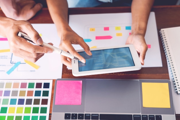 Business technology concept, creative team designer choosing samples with ui/ux developing on sketch layout design on smartphone application for mobile user interface design chart. Premium Photo