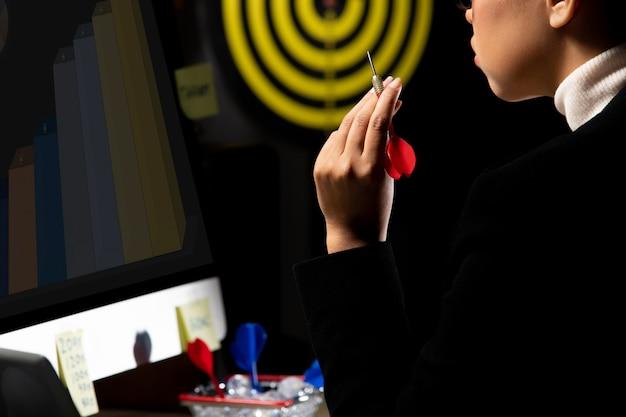 Business tomboy set dartboard as top target Premium Photo