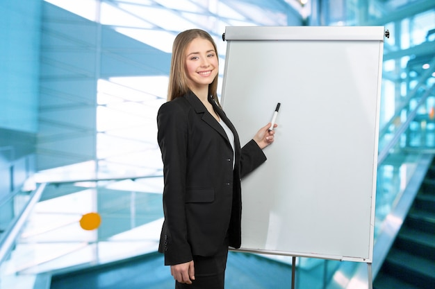 Business woman explain at the whiteboard Premium Photo