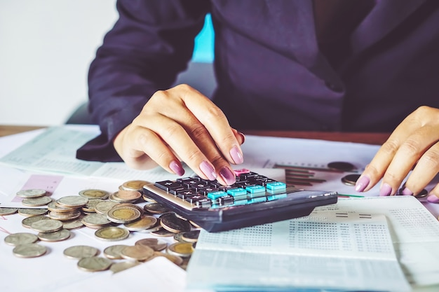 Business woman hand calculating saving money Premium Photo