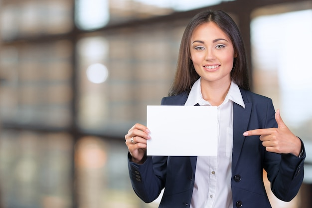 Business woman holding a banner Premium Photo