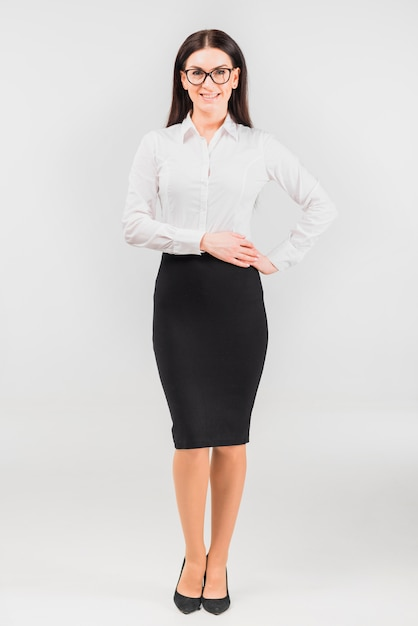 Business woman holding hands on waist Free Photo