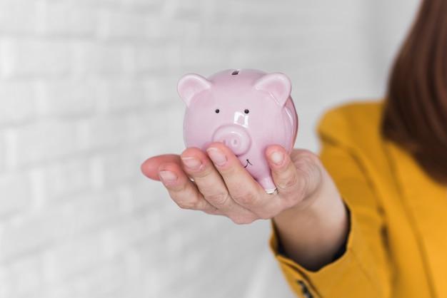 Business woman holding piggy bank Free Photo