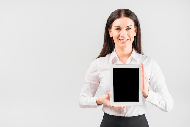 Business woman holding tablet with blank screen Free Photo