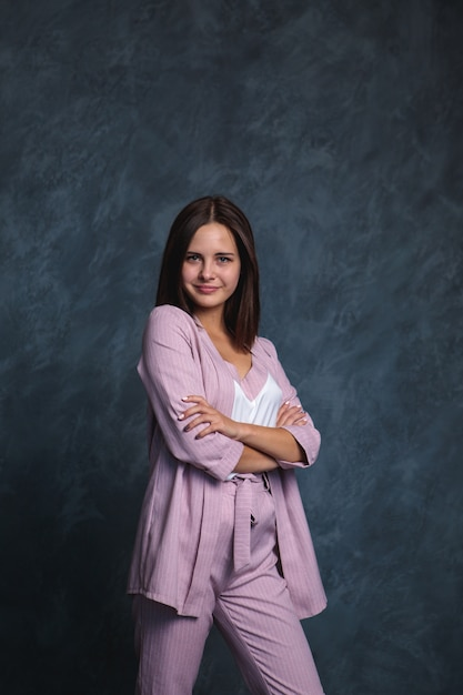 Business woman in a light suit on a dark Premium Photo