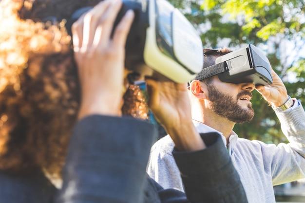 Business woman and man wearing virtual reality headset Premium Photo
