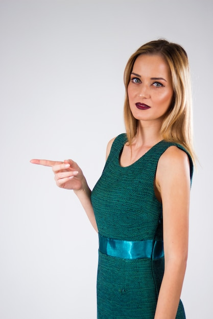 Business woman pointing with her hands atractive Free Photo