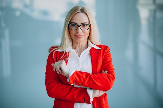 Business woman in red jacket isolated in office Free Photo