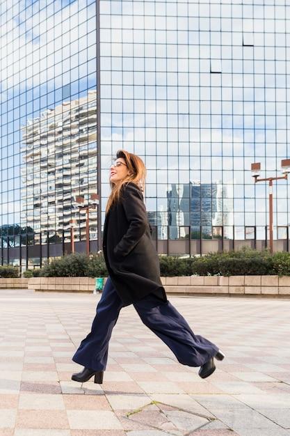 Business woman running on street Free Photo