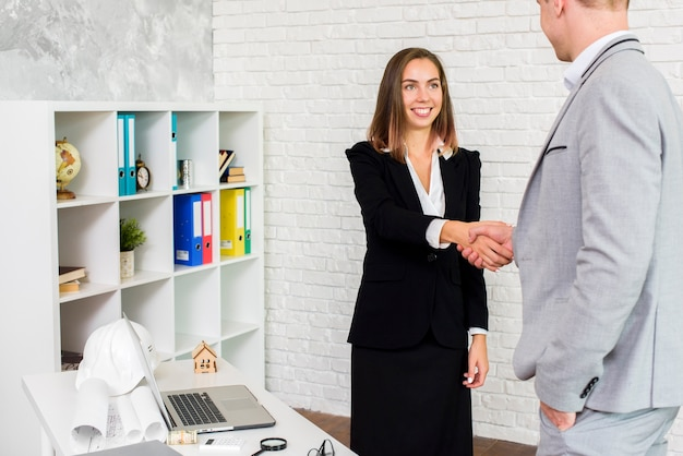 Business woman shaking hand with a man Free Photo