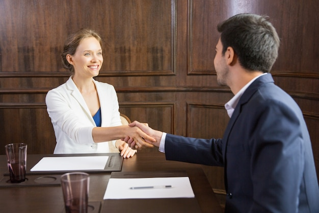 Business woman shaking hands with a man Free Photo