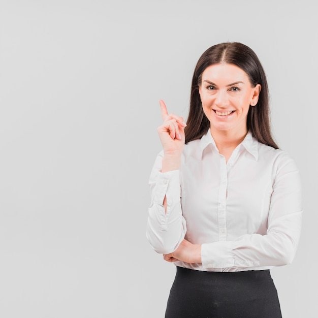 Business woman showing pointing finger Free Photo