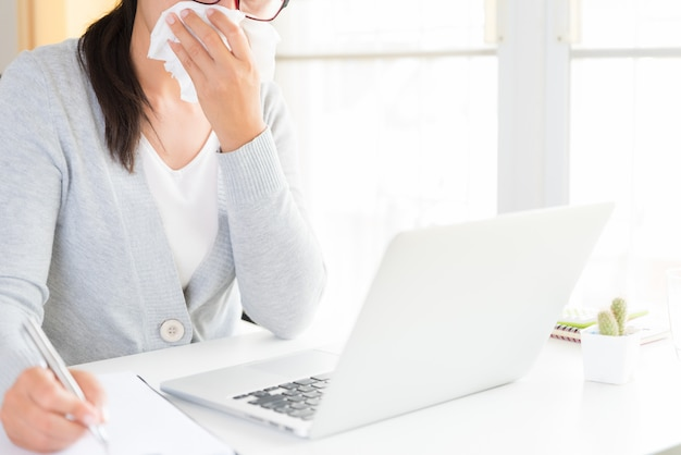 Business woman sick in the office, healthcare and medical concept. Premium Photo